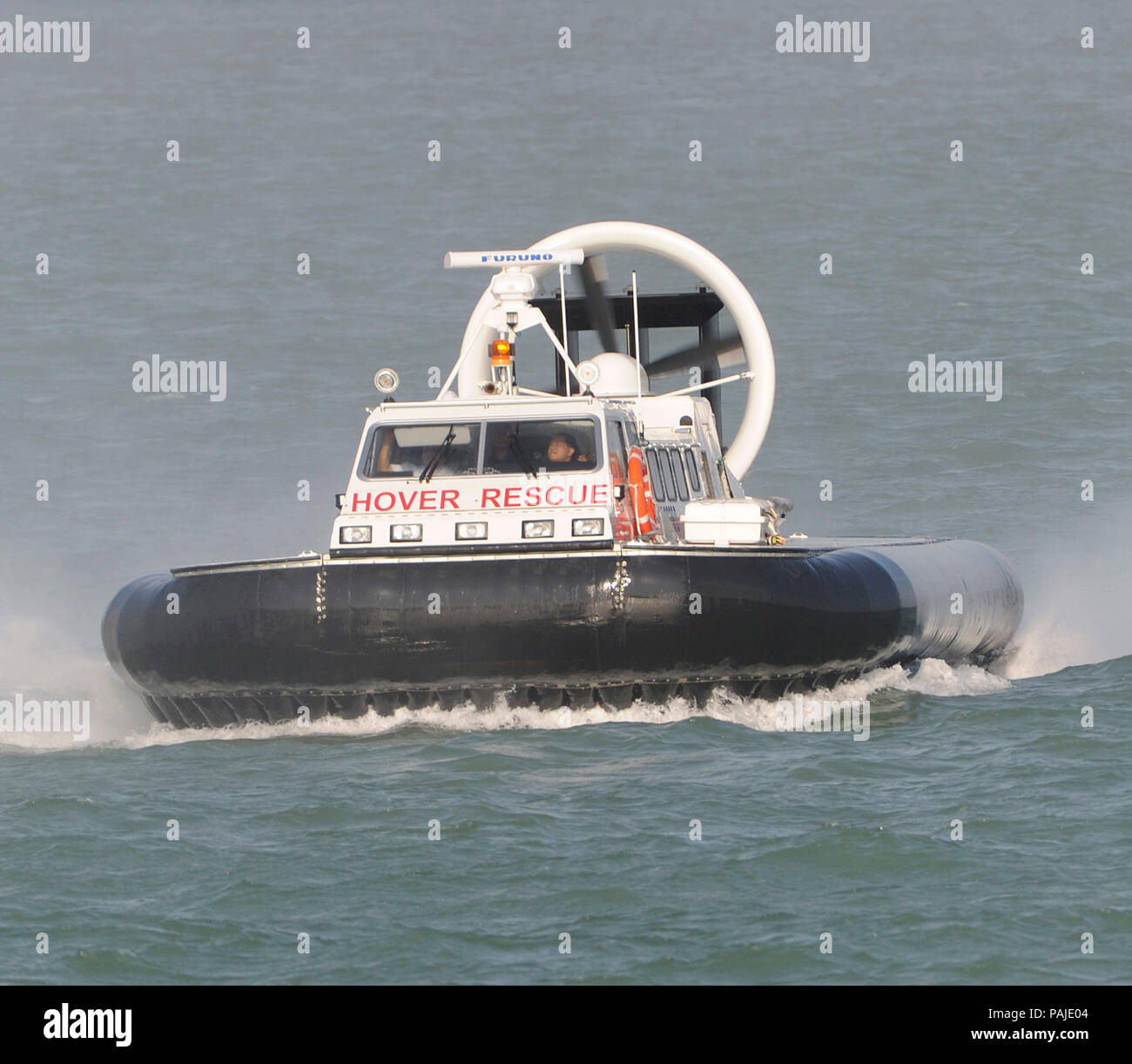 Changi-Airport Emergency Service brand-new Griffon Hoverwork 8000TD rescue hovercraft flying across the sea of the Straits of Singapore Stock Photo