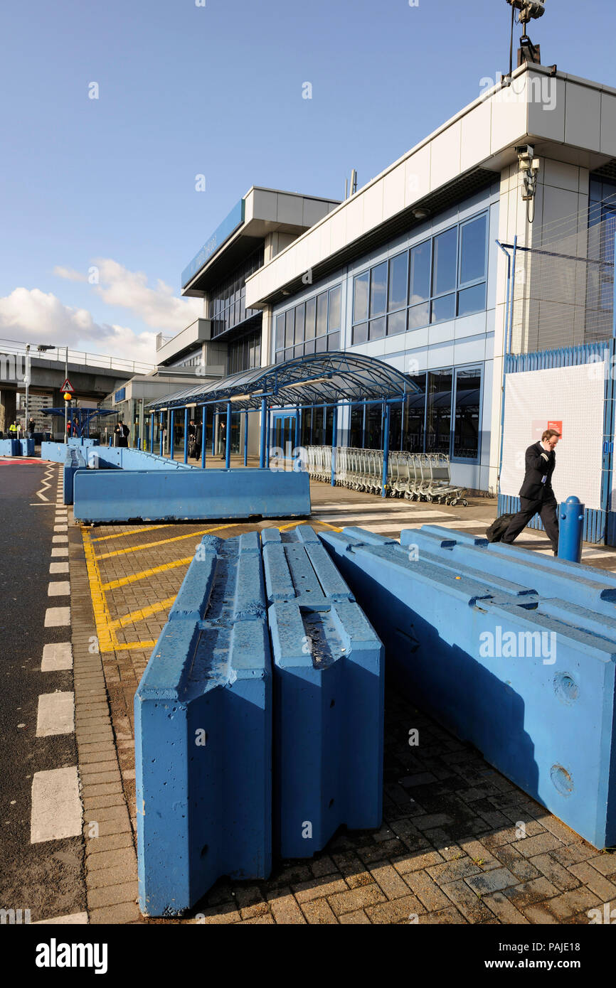 blue security barriers outside the terminal - Stock Image