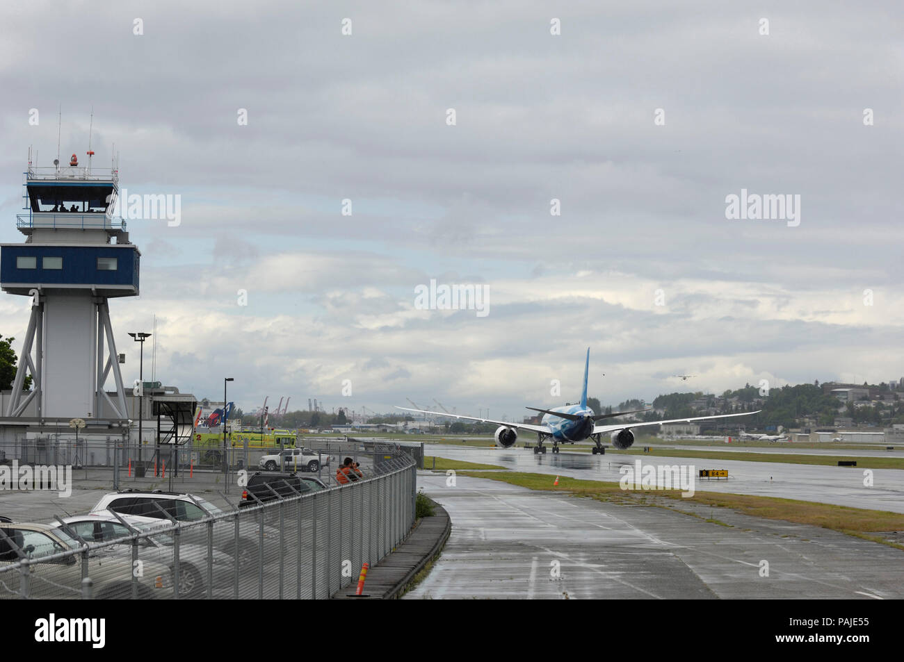 the first Boeing 787-8 Dreamliner prototype taxiing with air-traffic control-tower Stock Photo