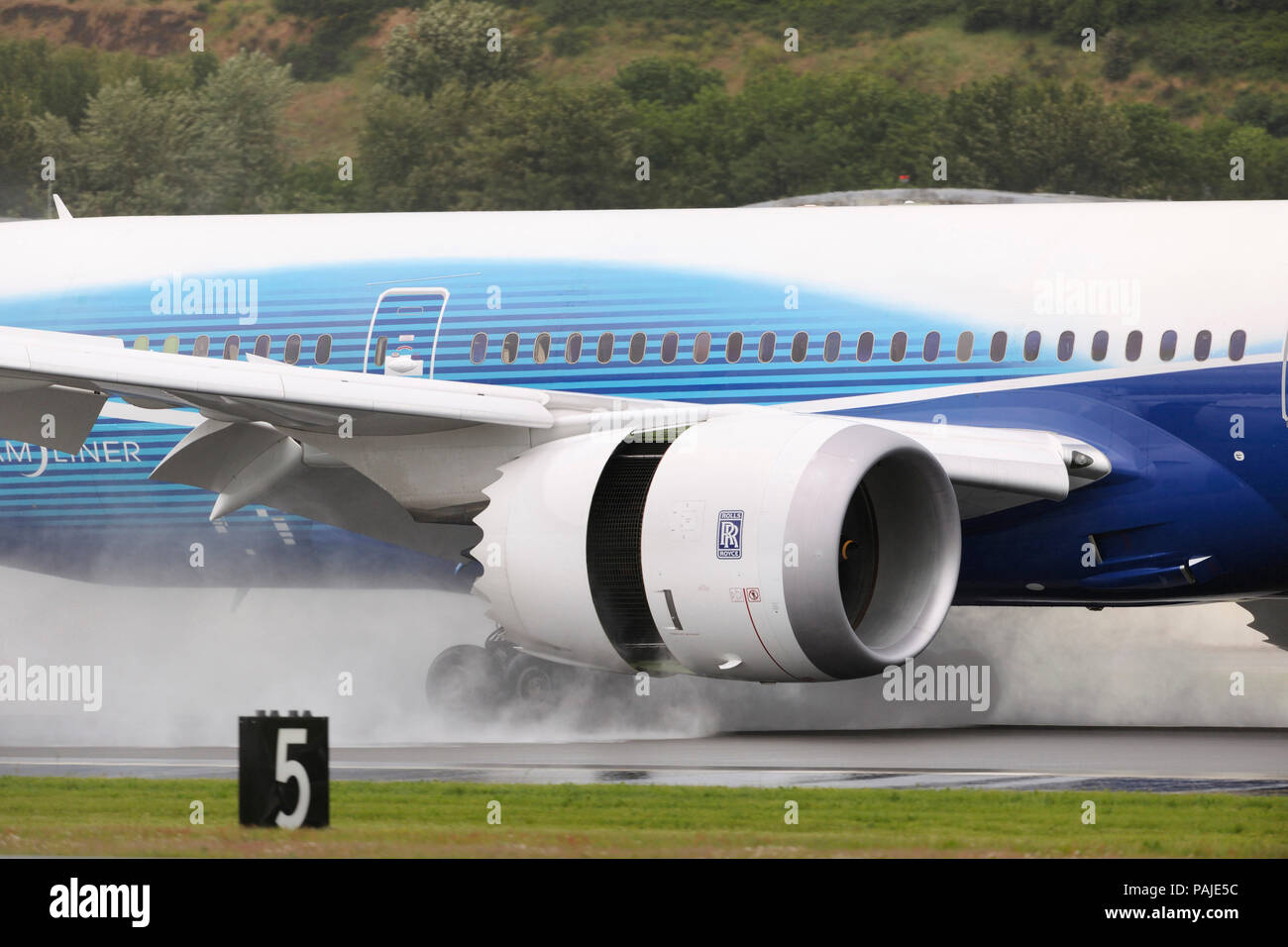Rolls-Royce Trent 1000 engine-cowling of the first Boeing 787-8 Dreamliner prototype landing Stock Photo