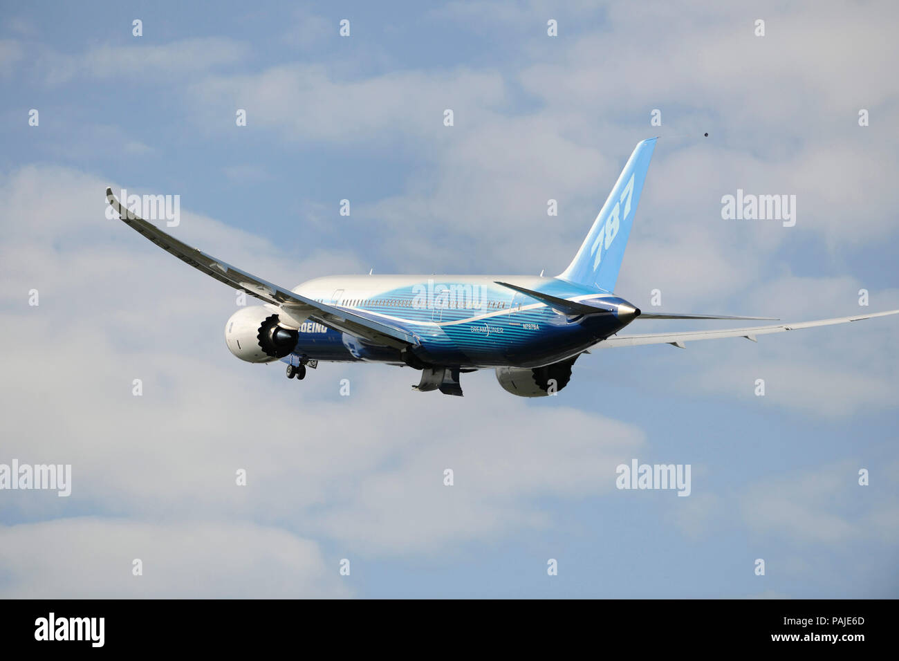 the first Boeing 787-8 Dreamliner prototype taking-off with undercarriage retracting Stock Photo