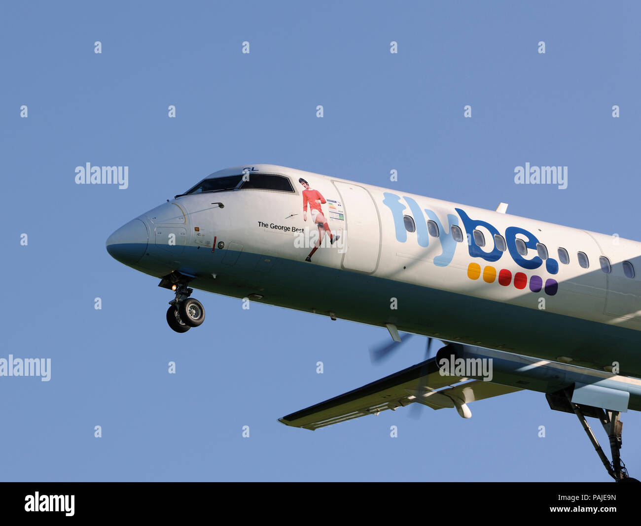 Flybe British European Bombardier DHC-8 Q400 on final-approach at Gatwick - Stock Image