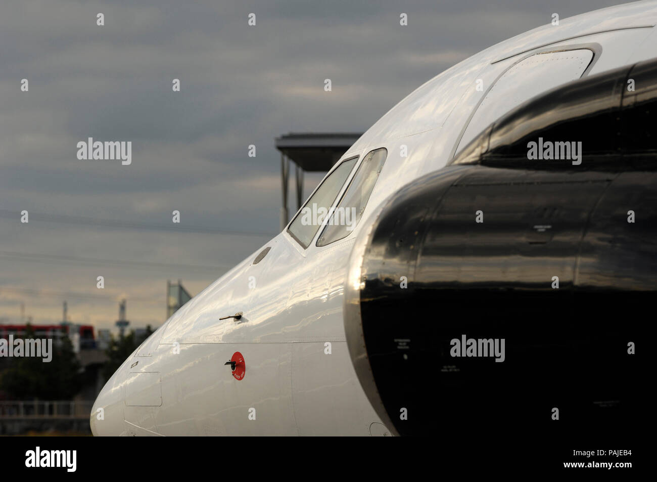 Honeywell ALF-502 engine-cowling and nose of Titan Airways BAE 146-200 QC taxiing at London City - Stock Image