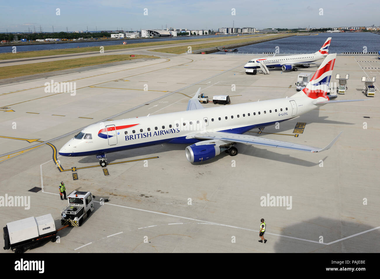 British Airways BA CityFlyer Embraer 190LR taxiing with Embraer 190 parked behind at London City Stock Photo