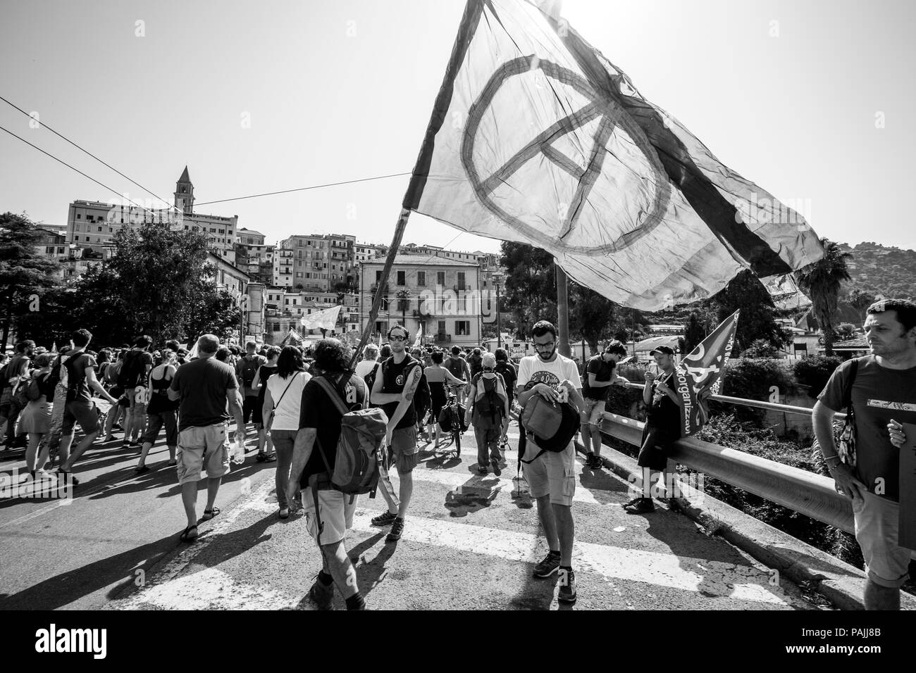 Ventimiglia, Italy, 14.07.2018: People who protest with anarchy flag during an anti-racist demonstration in Ventimiglia. - Stock Image