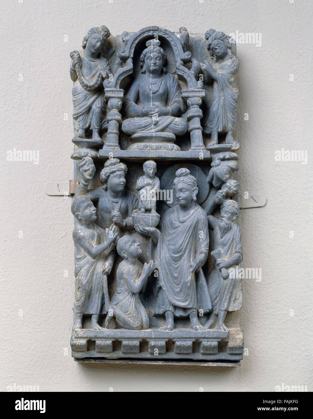 Relief Panel:  Presentation of a Statue. Culture: Pakistan (ancient region of Gandhara). Dimensions: 11 7/8 x 6 in. (30.2 x 15.2 cm). Date: 3rd-5th century. Museum: Metropolitan Museum of Art, New York, USA. Stock Photo