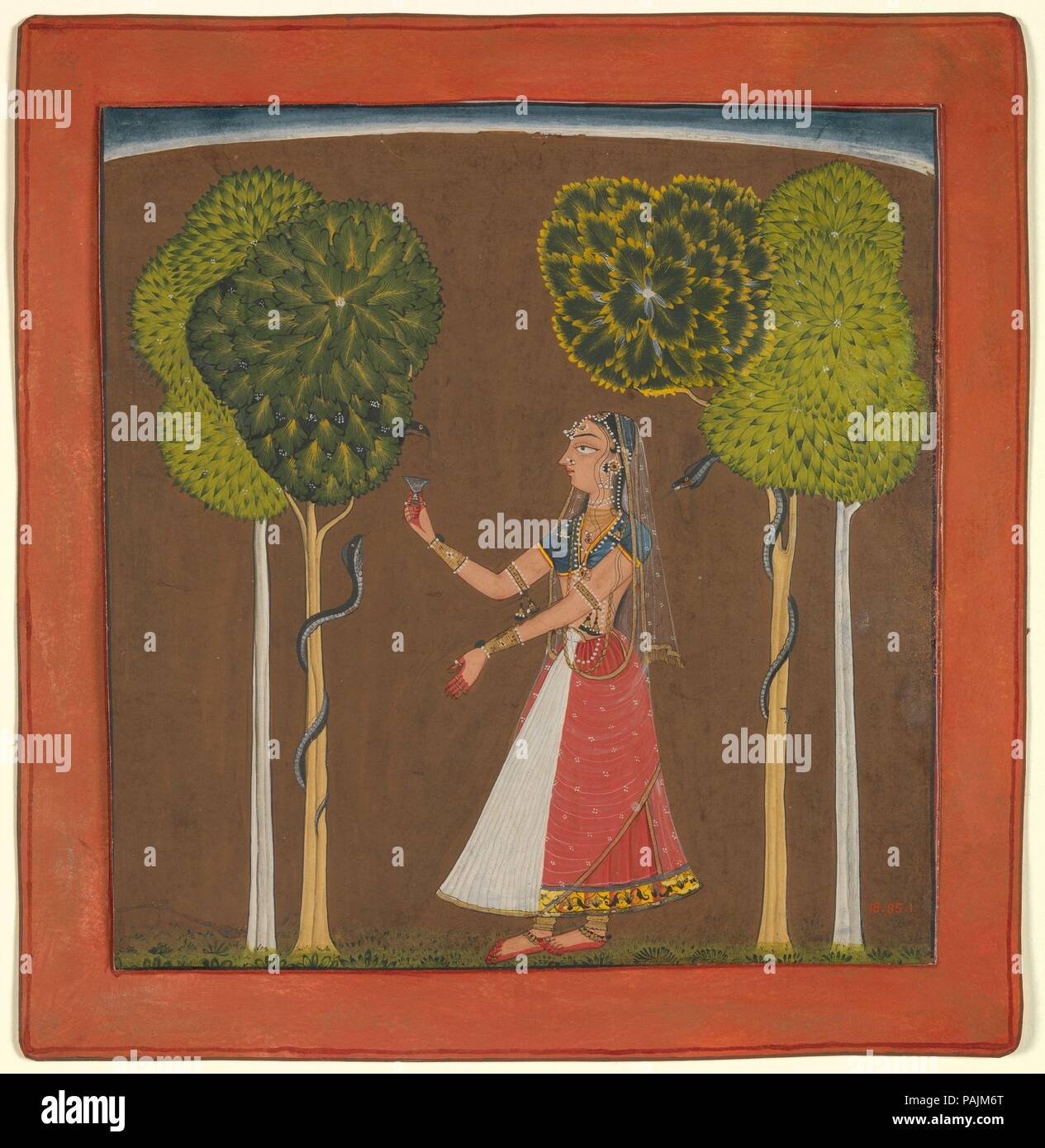 Ragini, possibly Asavari: Folio from a Ragamala Series. Culture: India (Himachal Pradesh, Mankot). Dimensions: Image: 7 in. × 6 5/8 in. (17.8 × 16.8 cm)  Sheet: 8 3/8 × 8 1/8 in. (21.3 × 20.6 cm). Date: ca. 1700-1710.  In this pictorial metaphor for a raga (a musical phrase that is used as the basis for improvisation), a lady charms the snakes entwining the adjacent trees. The tree motifs frame the young woman, seen against a monochromatic ground with arching skyline, gesturing to the snakes who respond to her movements. In a related theme, the Abhiri Ragini, the woman feeds the snakes milk fr - Stock Image