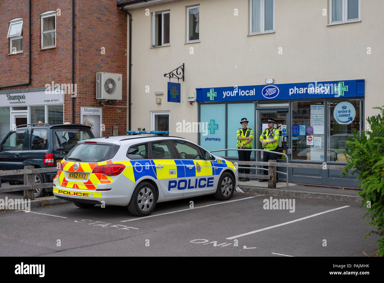 Police guard Boots the Chemist pharmacy during the Novichok poisoning which caused a major incident in the town at the beginning of July 2018 - Stock Image