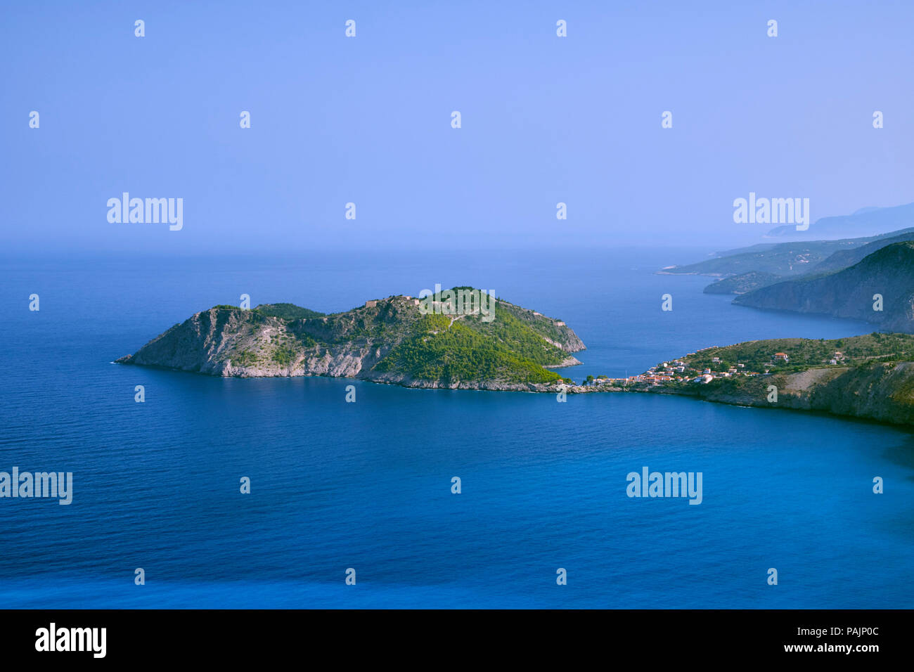 Village of Assos and its castle on the Gulf of Myrtos.  Cephalonia, Ionian Islands, Greece. - Stock Image