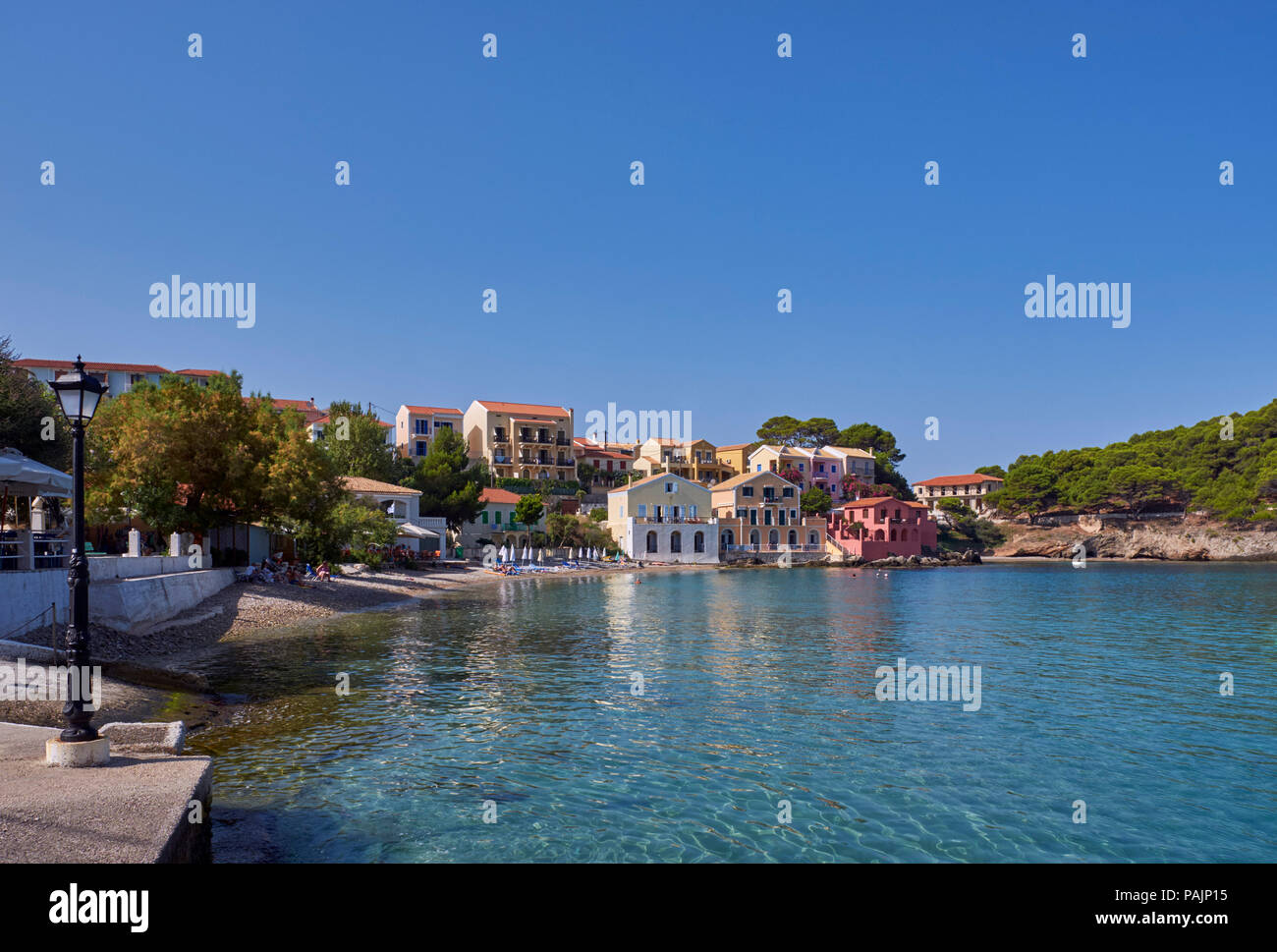 Village of Assos with houses overlooking its bay. Cephalonia, Ionian Islands, Greece. - Stock Image