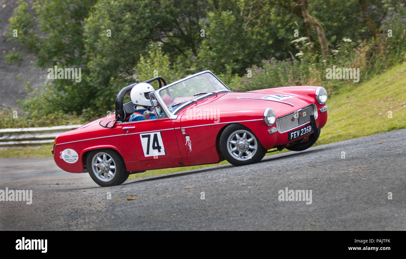 MG Midget driven by Neil Thomas racing at Hill Climb race Llys y Fran near  Haverfordwest Pembrokeshire Wales UK.car on bend lifting on two 2 wheels