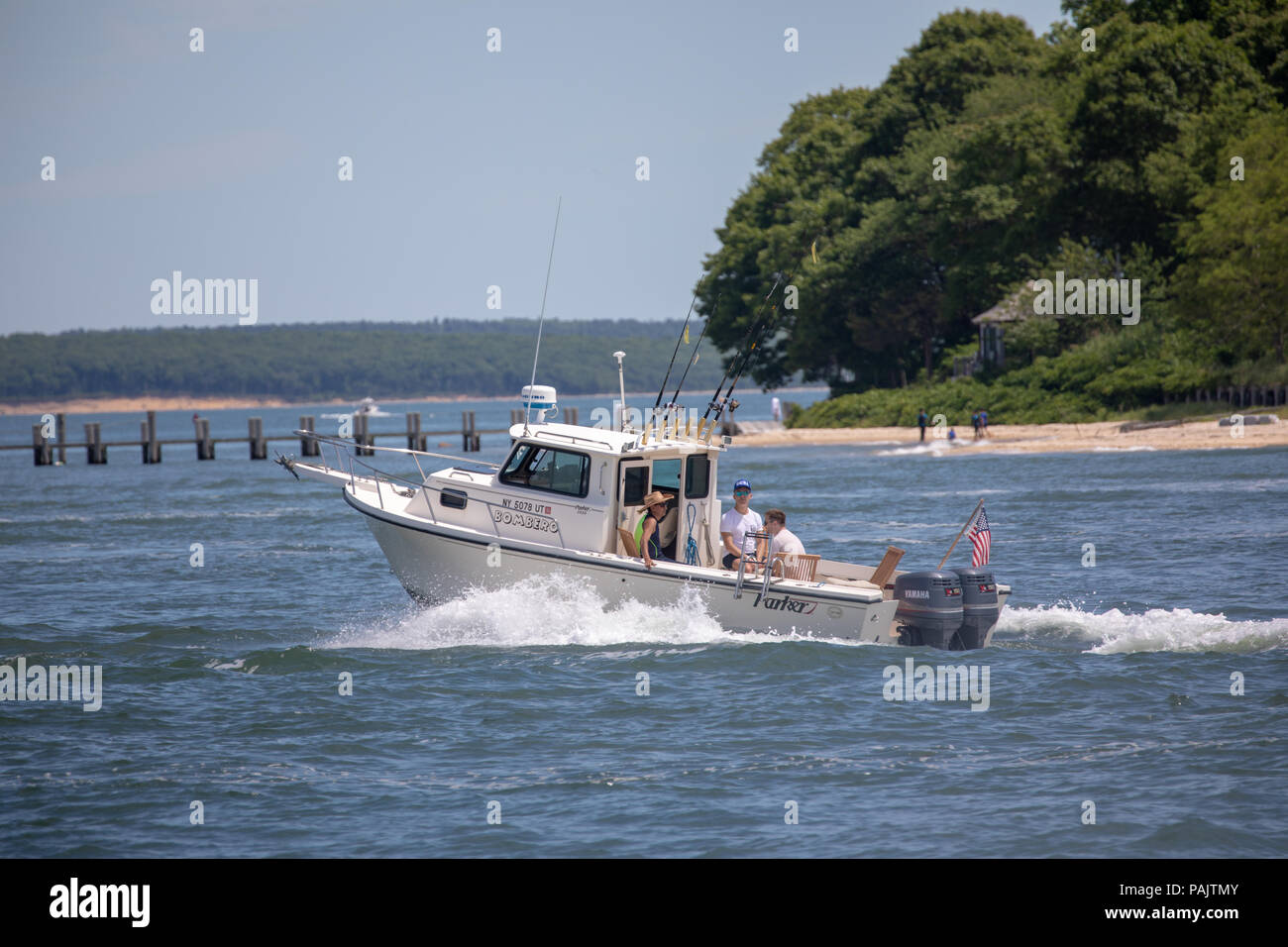 people on a motor boat near North Haven, NY - Stock Image
