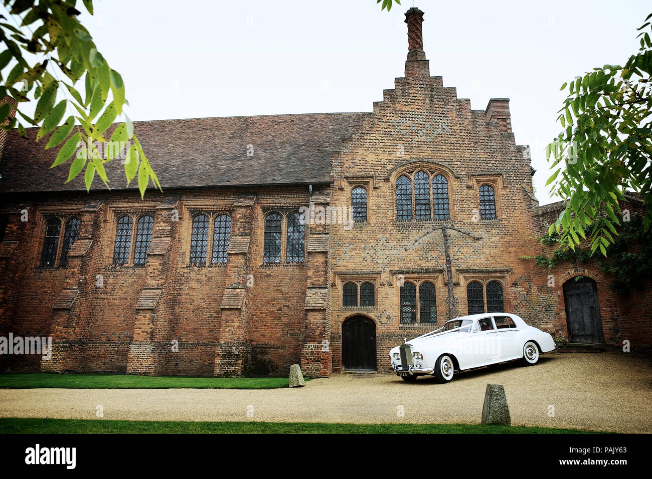 The Old Palace, Hatfield House, Hertfordshire, UK. With white Rolls Royce wedding car. - Stock Image