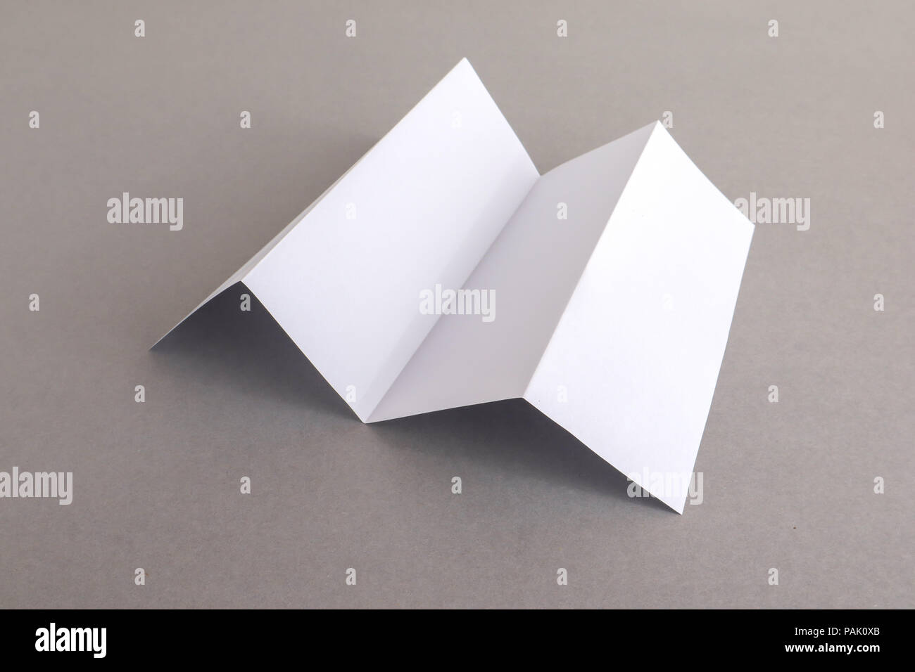 Template Fold White Paper On Gray Background Bussnese Concept Stock