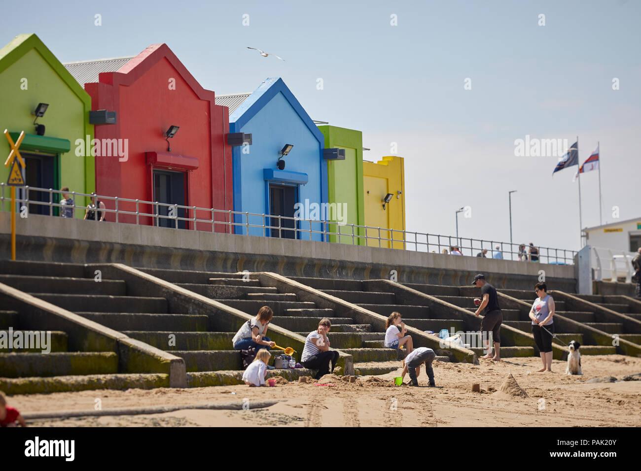 Prestatyn seaside coatal resort town Denbighshire, Wales. Historically  Flintshire,  central beech shop bright colours - Stock Image