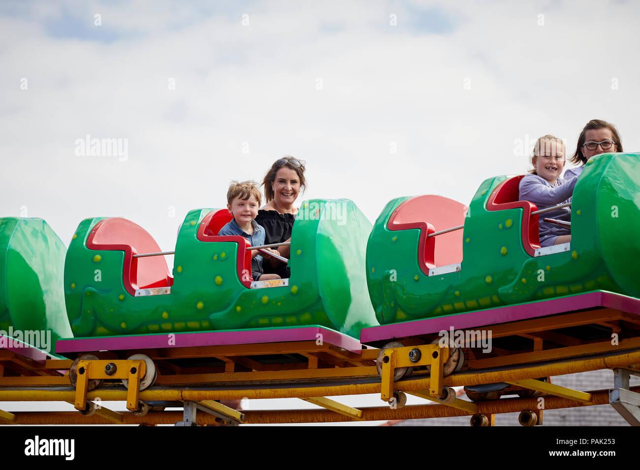 Rhyl seaside coastal resort town Denbighshire, north Wales. Historically  Flintshire, Nessi small rollercoaster ride on the promenade - Stock Image