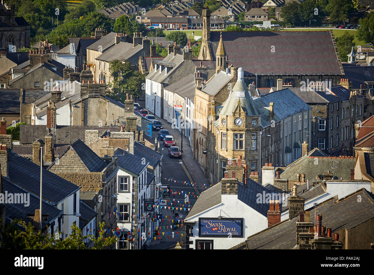Clitheroe Borough of Ribble Valley Lancashire  The town centre framed by the landmark library building and clock face a Grade II listed building - Stock Image
