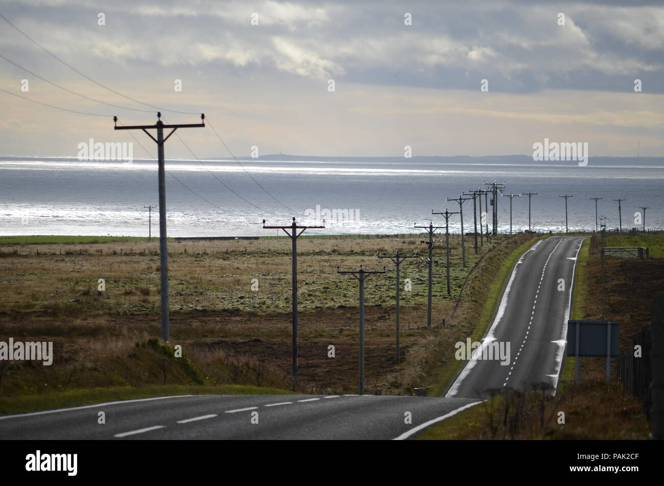 A road in the Orkney Islands in the British Isles - Stock Image