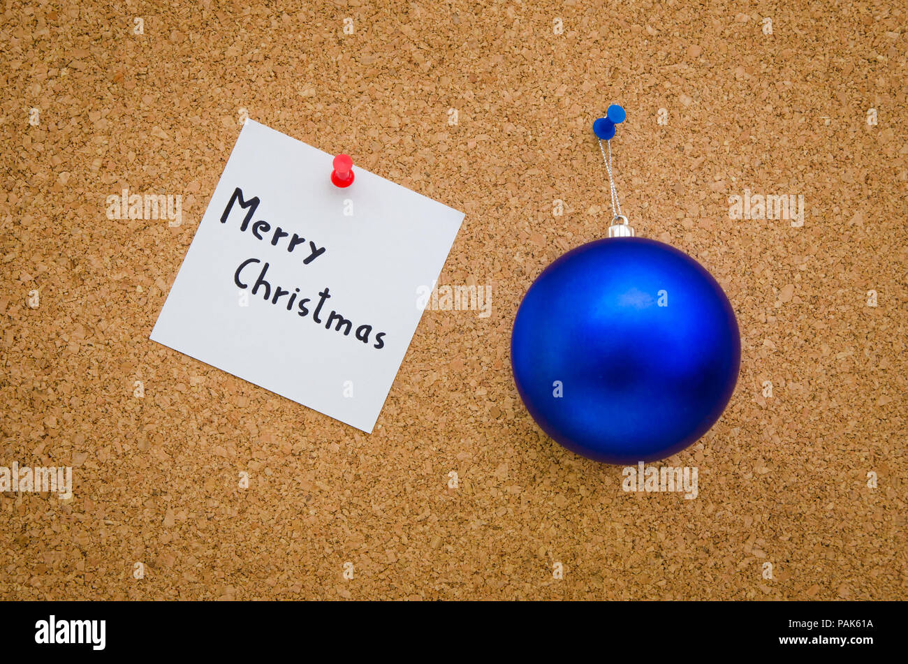 Merry Christmas Written On A Paper Note With A Blue Christmas Globe