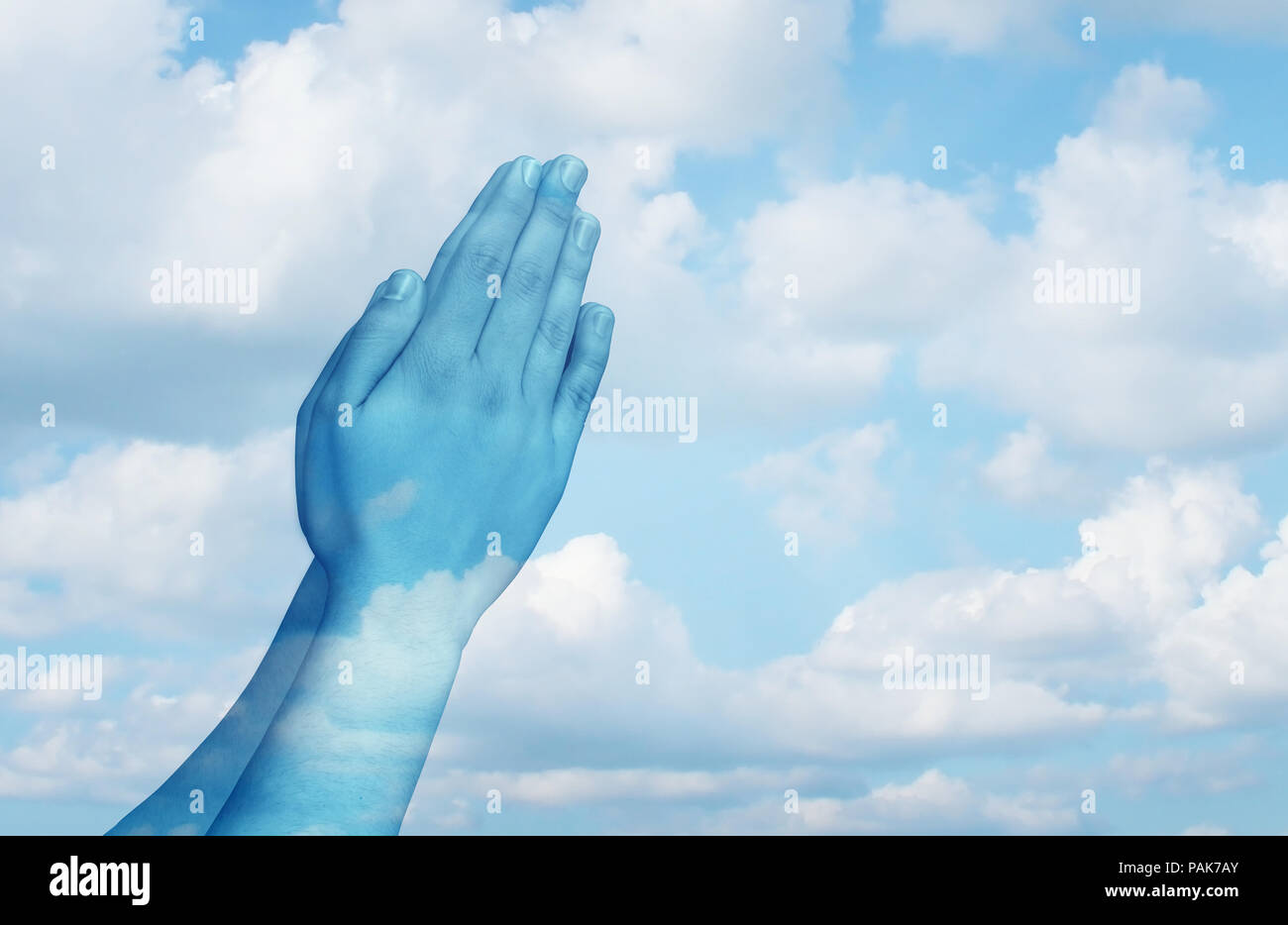 Praying and spiritual life concept as hands in worship on a sky background as a symbol for belief and spirituality in religion. - Stock Image