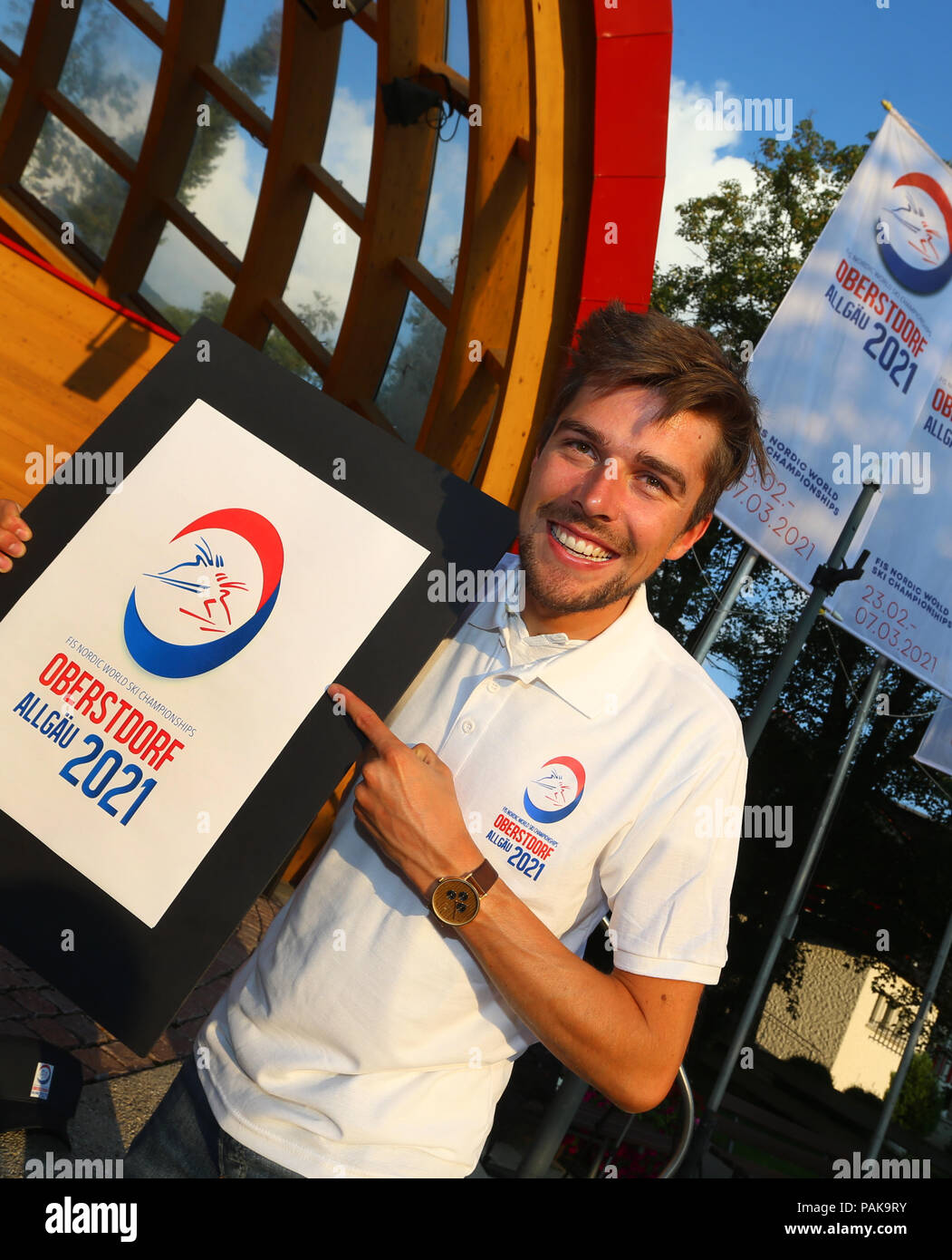 Oberstdorf, Germany. 23rd July, 2018. 23.07.2018, Bayern, Oberstdorf: The Nordic Combine Johannes Rydzek presents the logo for the FIS Nordic World Ski Championships 2021. Credit: Karl-Josef Hildenbrand/dpa/Alamy Live News - Stock Image