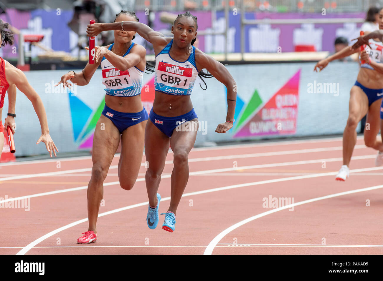 London, UK. 22nd July 2018. Bianca Williams (GBR) takes the baton from Imani Lansiquot (GBR) in the 4x100m at the Muller Anniversary Games at the London Stadium, London, Great Britiain, on 22 July 2018. Credit: Andrew Peat/Alamy Live News - Stock Image