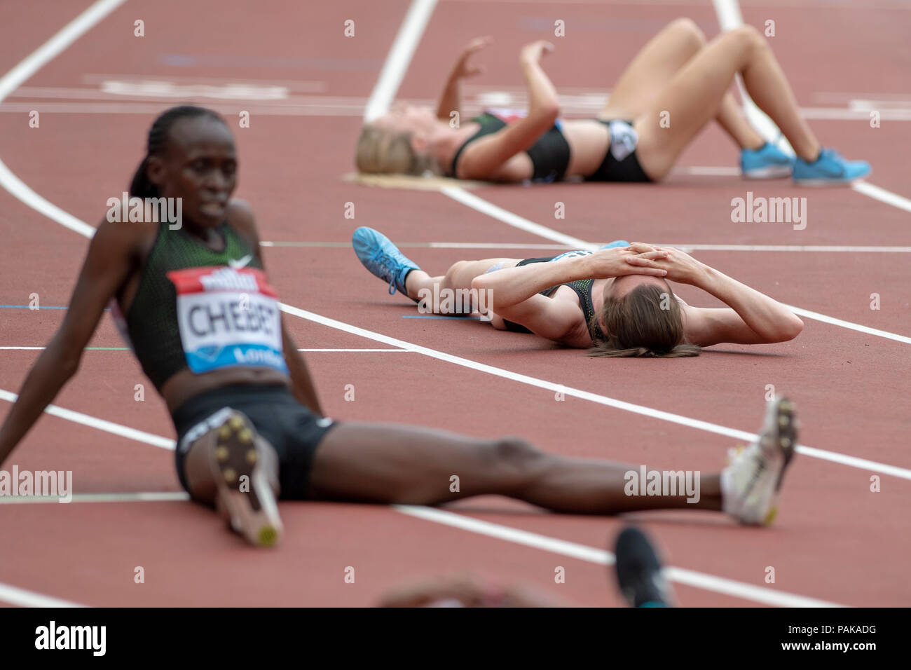 London, UK. 22nd July 2018. Laura Muir (GBR) collapsed on the track with other athletes after the Millicent Fawcett Mile at the Muller Anniversary Games at the London Stadium, London, Great Britiain, on 22 July 2018. Credit: Andrew Peat/Alamy Live News - Stock Image