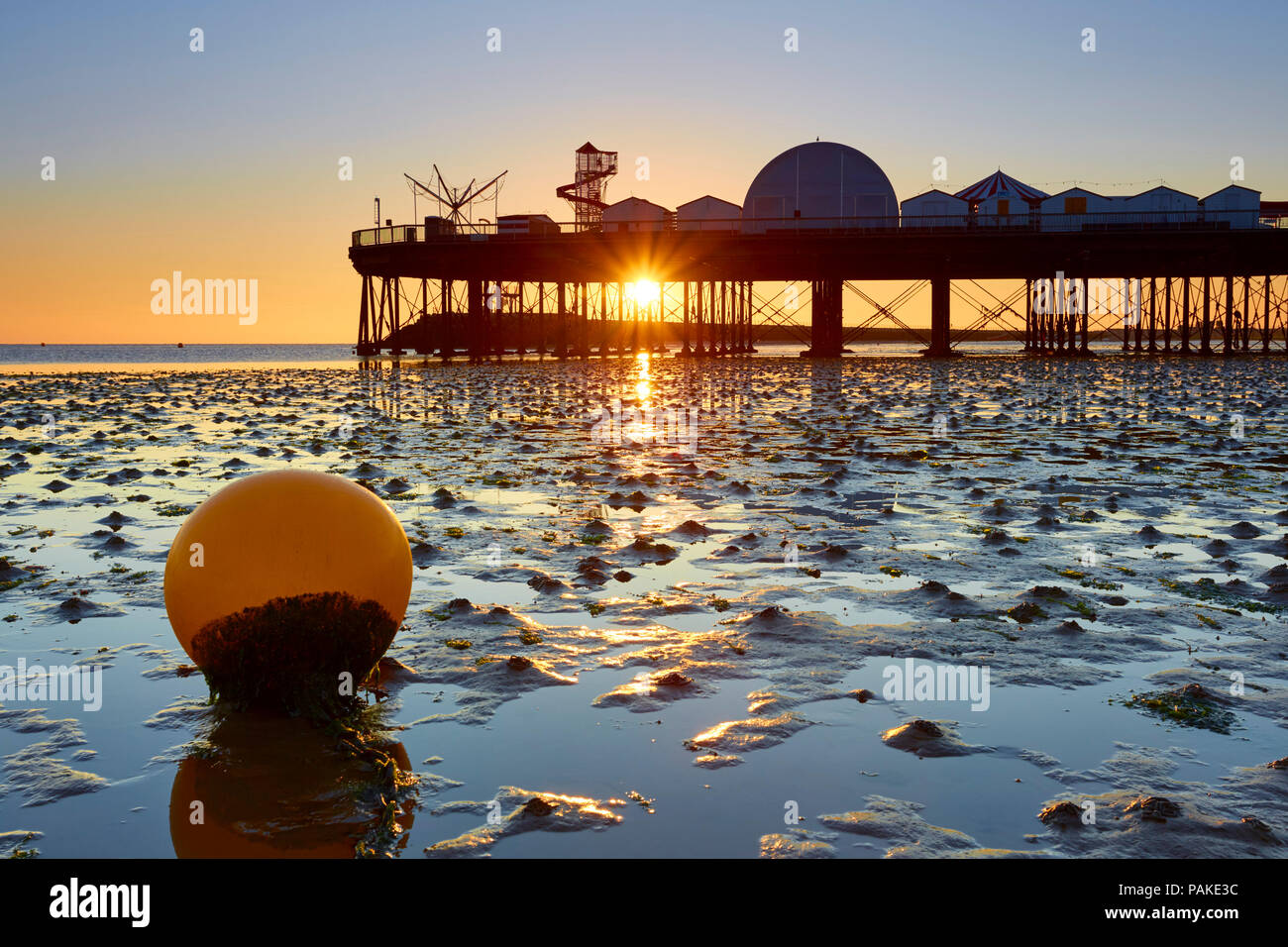 Herne Bay, Kent, UK. 24th July 2018: UK Weather. Sunrise at Herne Bay pier. With temperatures predicted higher than 30°C many people will be flocking to the seaside for the holiday season. The high temperatures could last into next week, and with clear skies people are advised to stay out of the sun between 11am and 3pm. Credit: Alan Payton/Alamy Live News - Stock Image