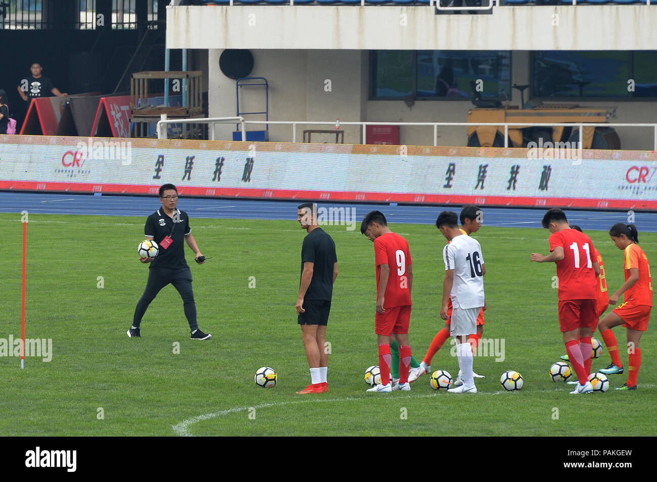 Beijin, Beijin, China. 24th July, 2018. Beijing, CHINA-Portuguese professional footballer Cristiano Ronaldo interacts with Chinese young football players at Beijing Olympic Sports Center in Beijing, China. Credit: SIPA Asia/ZUMA Wire/Alamy Live News - Stock Image