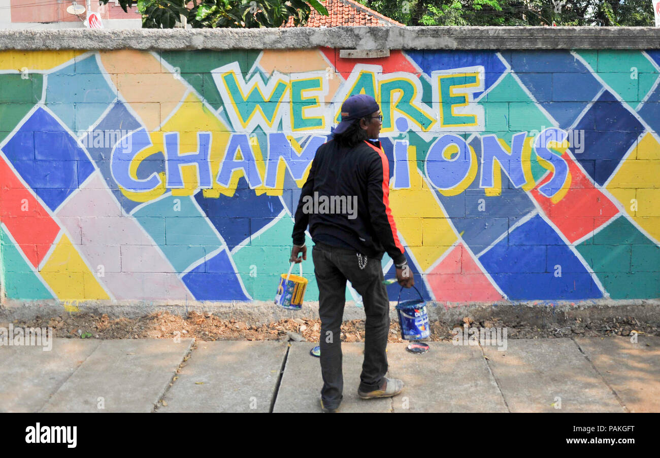 A man creates graffiti with the theme of the asian games in jakarta indonesia july 24 2018 credit zulkarnain xinhua alamy live news