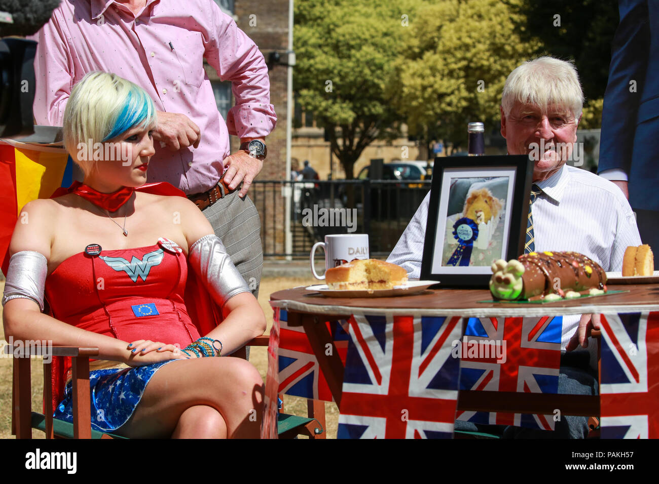 London, UK. 24th July, 2018. EU Supergirl Madeleina Kay and Stanley Johnson, father of Boris Johnson, are interviewed for the last ever broadcast of BBC2 news programme the Daily Politics on College Green in Westminster. The BBC announced last week that the BBC2 lunchtime slot will be filled from September by a new show called Politics Live. Credit: Mark Kerrison/Alamy Live News - Stock Image