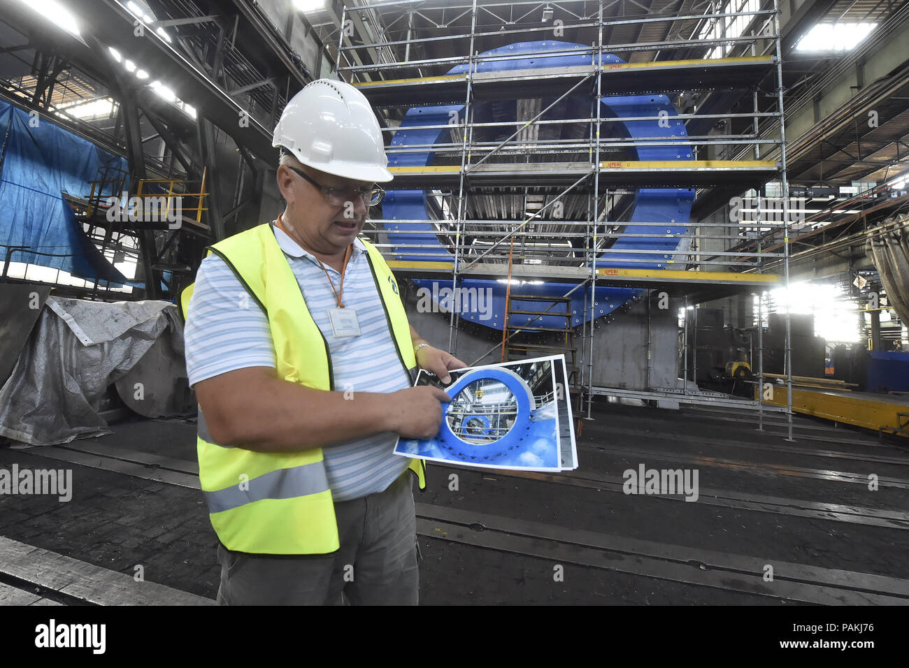 Ostrava, Czech Republic. 24th July, 2018. Press briefing on completion of prestigious project and providing magnet parts of particle accelerator for international nuclear research at Joint Institute for Nuclear Research (JINR) based in Russia took place in Vitkovice Heavy Machinery (VHM) production plant on July 24, 2018, in Ostrava, Czech Republic. On the photo is seen Nikolay Topilin of JINR. (CTK Jaroslav Ozana) - Stock Image