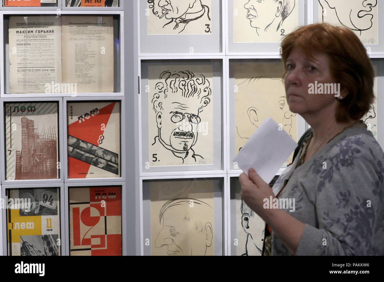 Moscow, Russia. 24th July, 2018. MOSCOW, RUSSIA - JULY 24, 2018: A visitor views early 1920s mocking portraits of LEF [Left Front of Arts] members on display at an exhibition titled 'Vladimir Mayakovsky - There and Over Here' and held at Moscow's Vladimir Dahl Russian State Literary Museum to mark Russian poet Vladimir Mayakovsky's 125th birthday. Sergei Savostyanov/TASS Credit: ITAR-TASS News Agency/Alamy Live News - Stock Image
