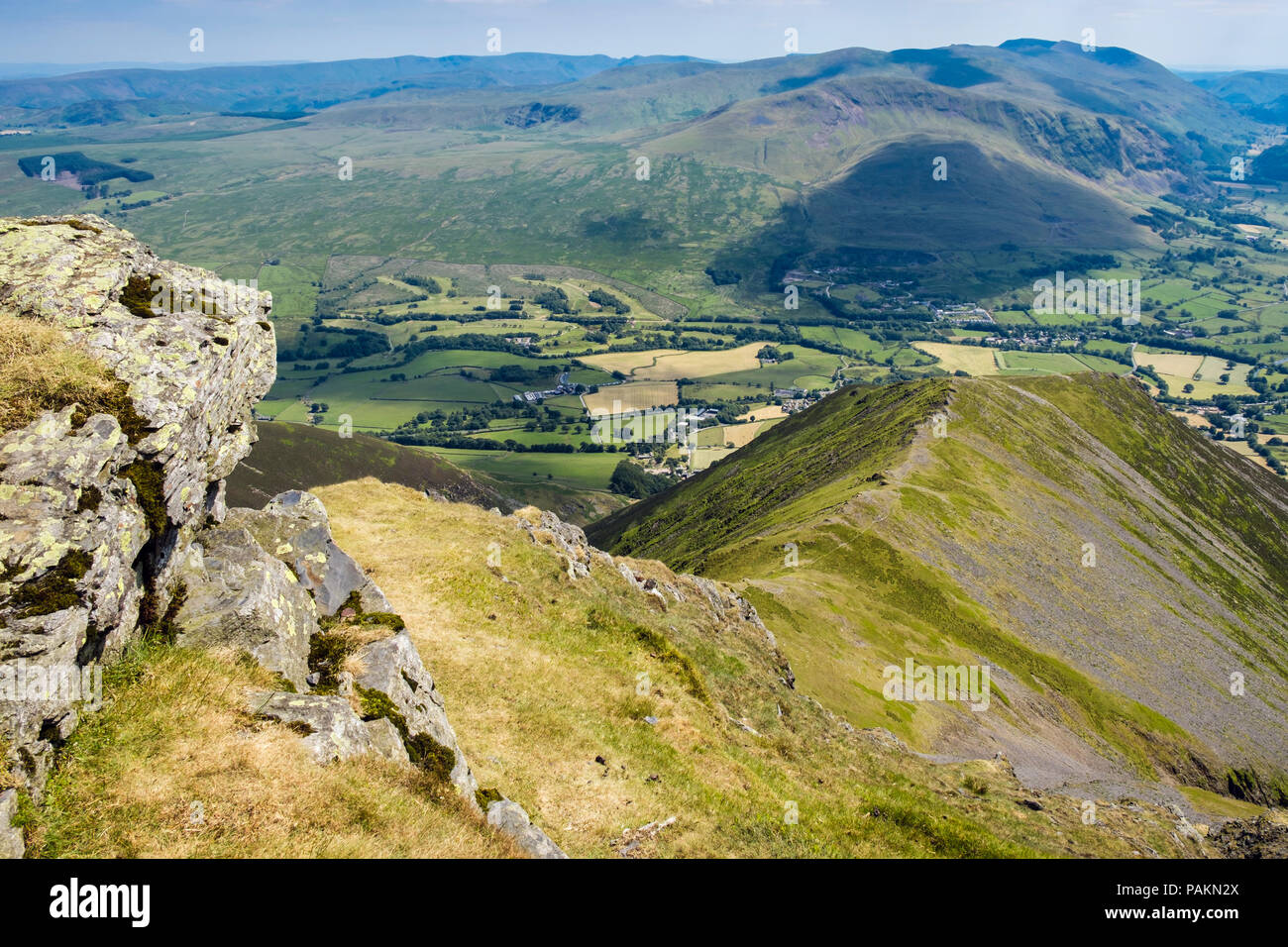 View down Halls Fell Top on Blencathra (Saddleback) summit ridge to Threlkeld, in northern Lake District National Park, Cumbria, England, UK, Britain - Stock Image