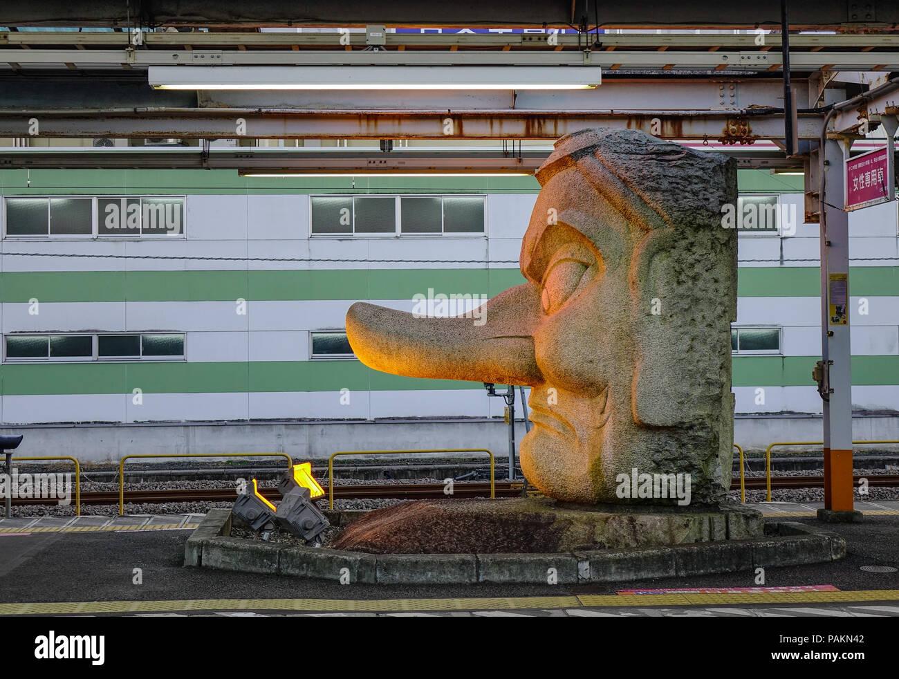 Nagoya, Japan - Dec 3, 2016. A God statue at platform of railway station in Nagoya, Japan. - Stock Image