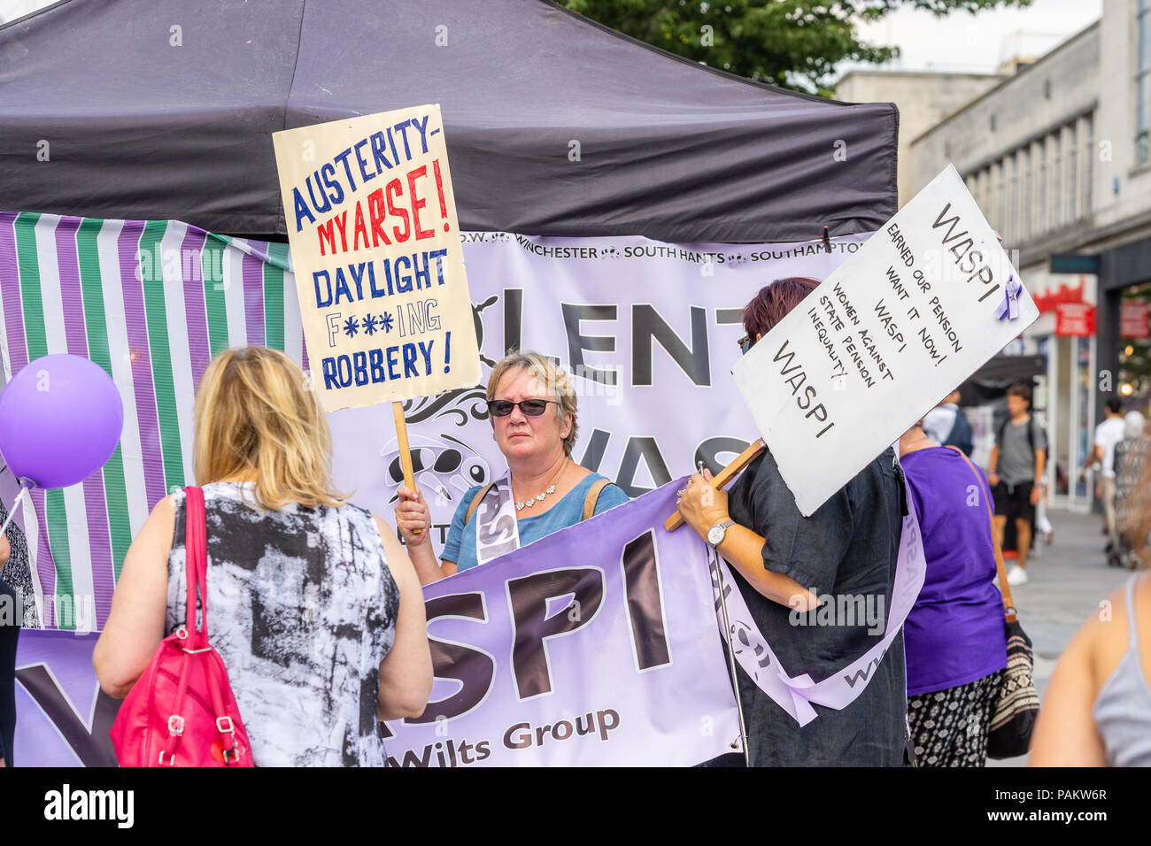 Women belonging to a WASPI campaign group  holding a protest in Southampton City Centre during the summer 2018, England, UK - Stock Image