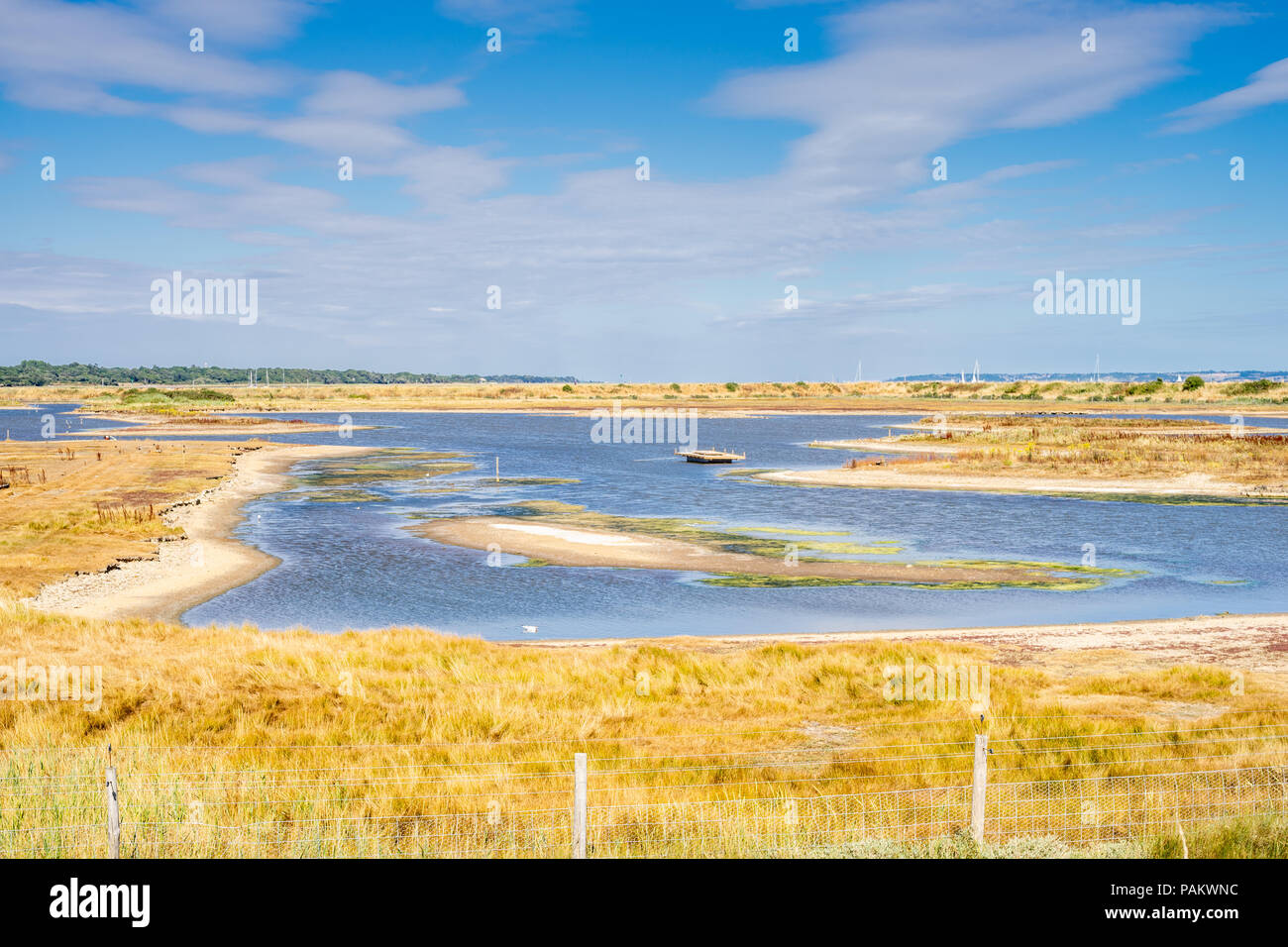 View over Lymington and the Keyhaven Marshes Nature Reserve during very dry weather conditions in July 2018, Lymington, Hampshire, England, UK - Stock Image