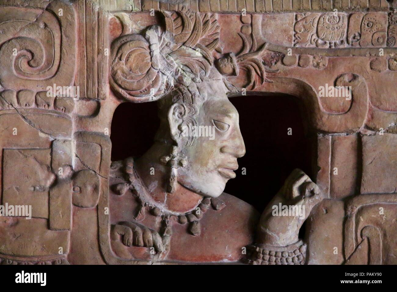 Mayan Emperor carved in pink stone in Guatemala - Stock Image