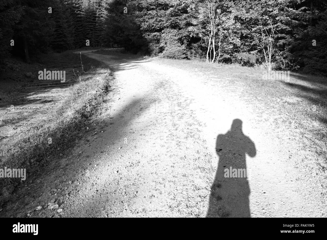 My shadow on the mountain road black and white - Stock Image