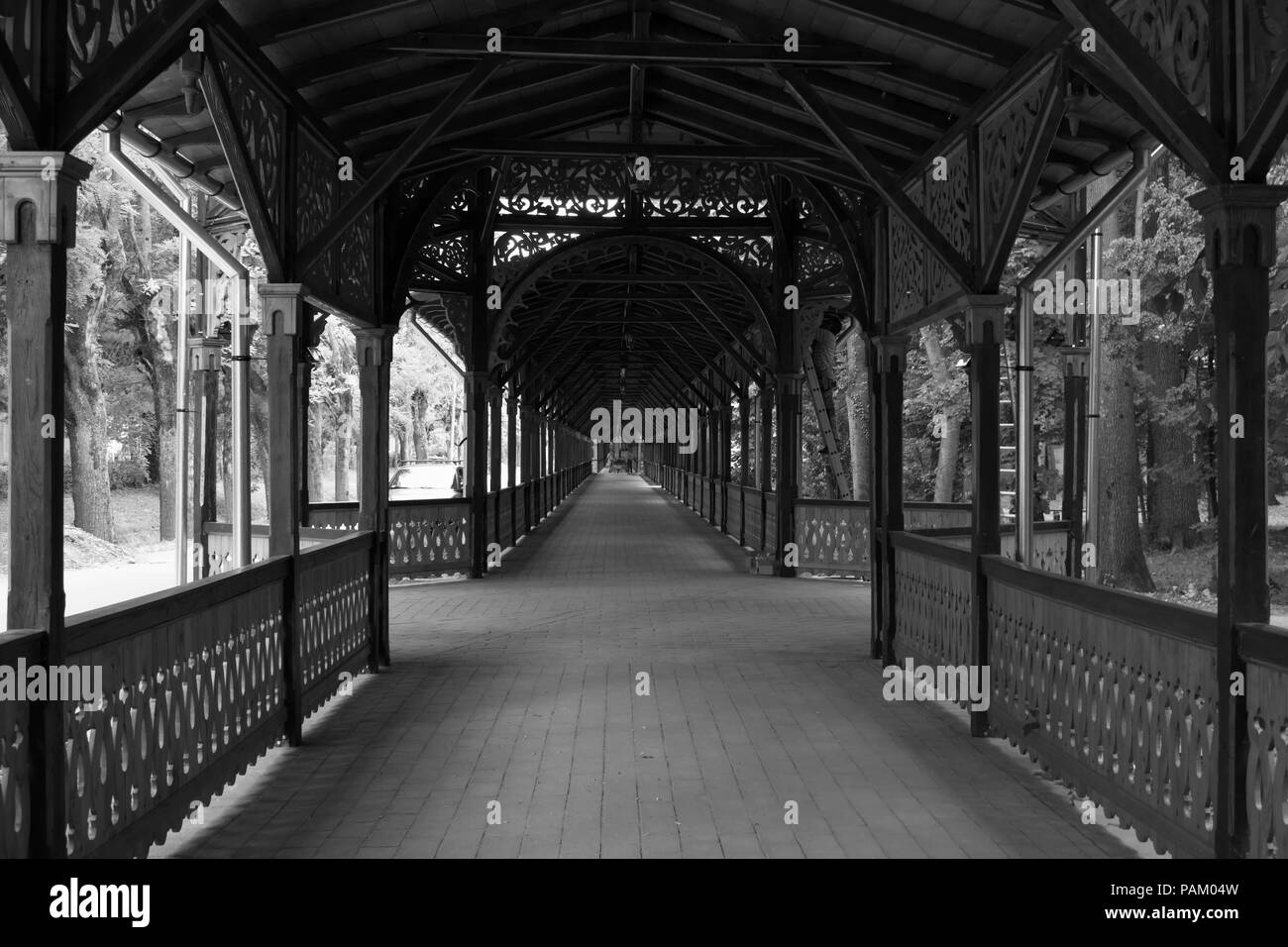 Colonnade walkway in Buzias, Romania in black and white - Stock Image