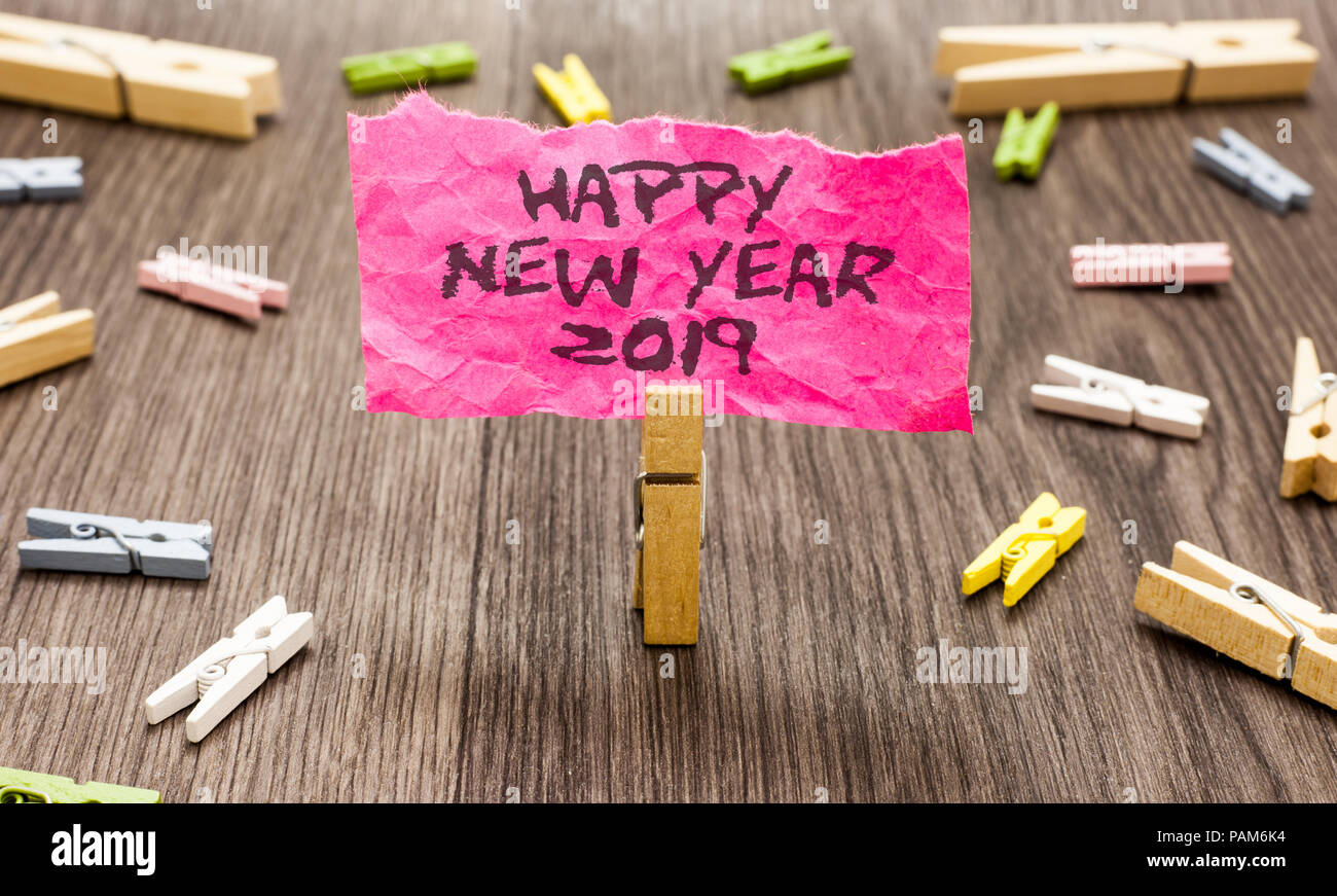 802409a9 Conceptual hand writing showing Happy New Year 2019. Business photo  showcasing Greeting Celebrating Holiday Fresh Start Best wishes Paperclip  hold pin
