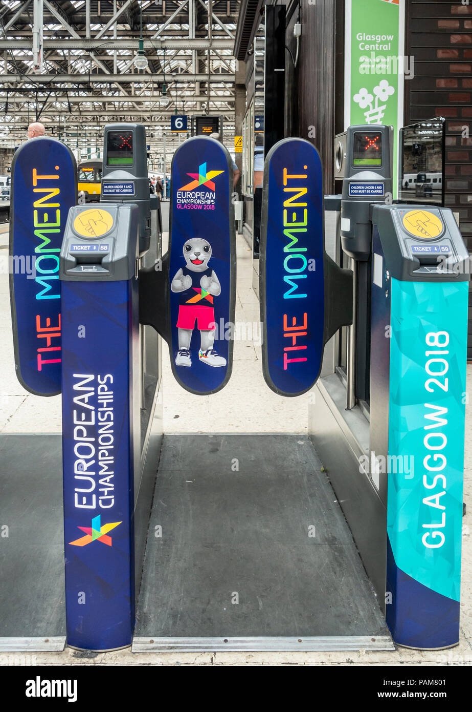 Barriers at Glasgow Central Station covered wtih branding reflecting Glasgow 2018, the European Championships, a multi-sports event hosted in Glasgow - Stock Image