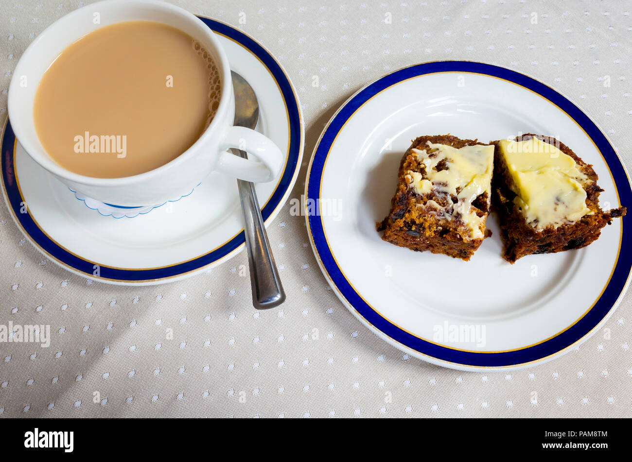Afternoon snack in E. Botham's  famous Yorkshire Café in Whitby a cup of tea with a slice of buttered brack a local type of rich fruit cake Stock Photo