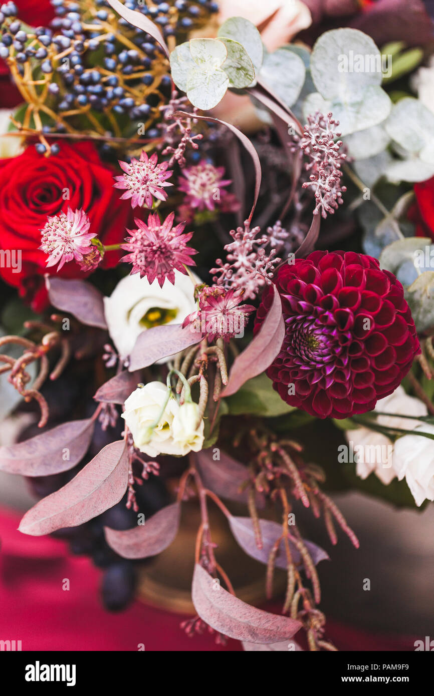 Wedding Decorations With Fresh Red And Vinous Color Flowers