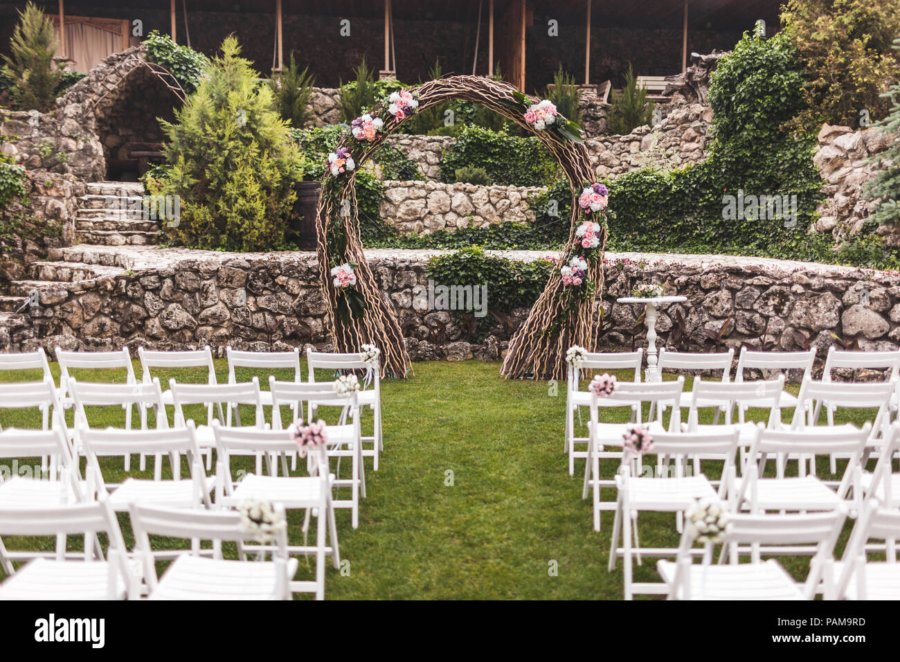 Cozy Rustic Wedding Ceremony With Flower Arch And Wooden White