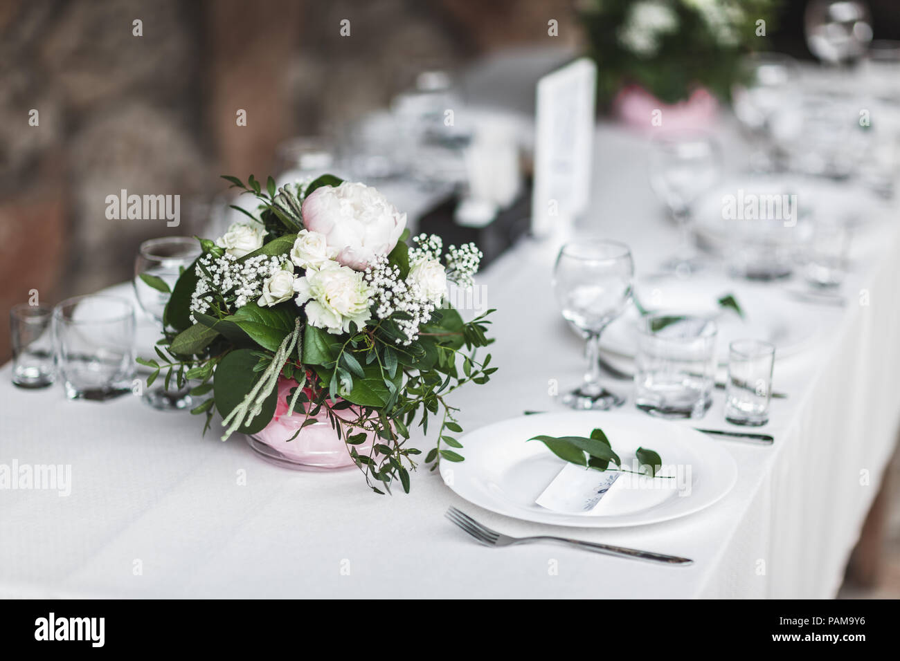 White Wedding Table Decorated With Green Flowers Arrangement Name