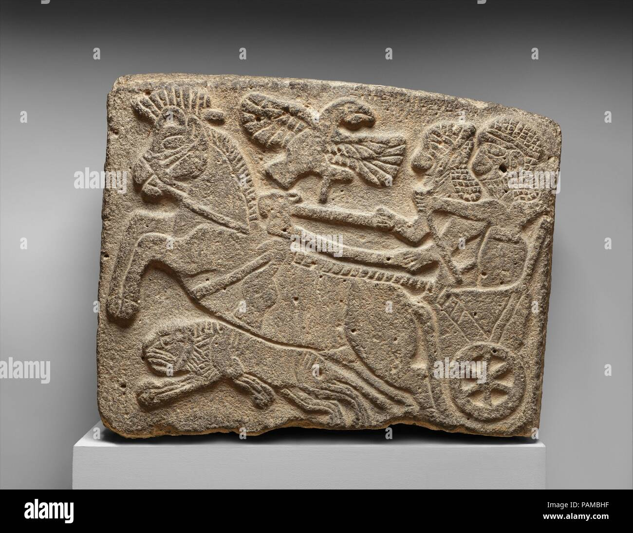 Orthostat relief: lion-hunt scene. Culture: Hittite. Dimensions: H. 22 in. (56 cm). Date: ca. 9th century B.C..  The powerful Neo-Assyrian Empire influenced the surrounding region culturally as well as politically. In the west a number of small but powerful Aramaean city-states acted as a barrier between Assyria and the Mediterranean coast. These have been called Neo-Hittite city-states because of their dynastic continuity and relation to the preceding Hittites of Anatolia. These rival states were gradually brought under the control of the Neo-Assyrian Empire by military conquest.  Stone slabs Stock Photo