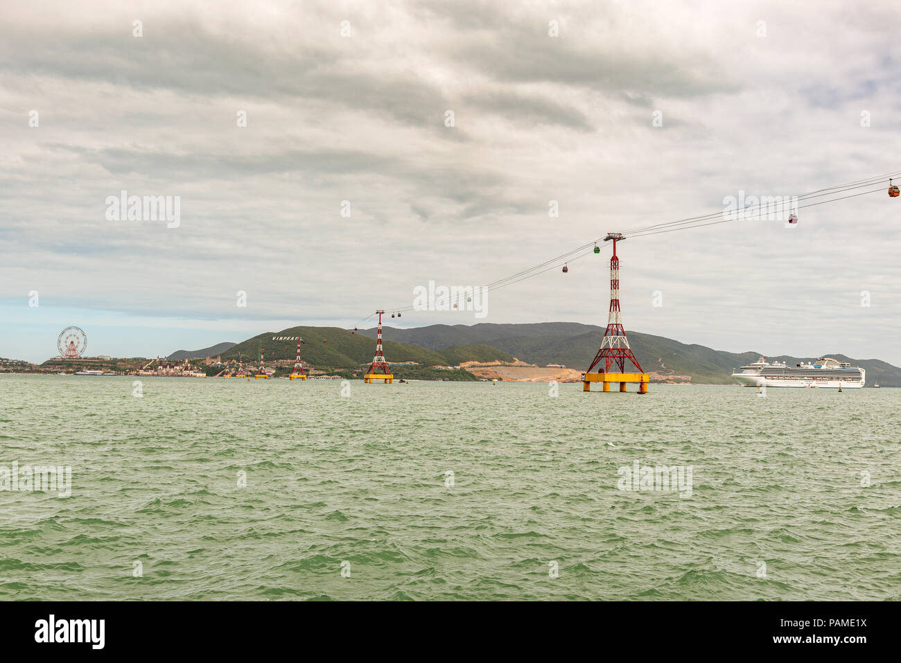 Cable car is running over the sea to Vinpearl Amusement Park on Hon Tre Island, Nha Trang, Vietnam. - Stock Image