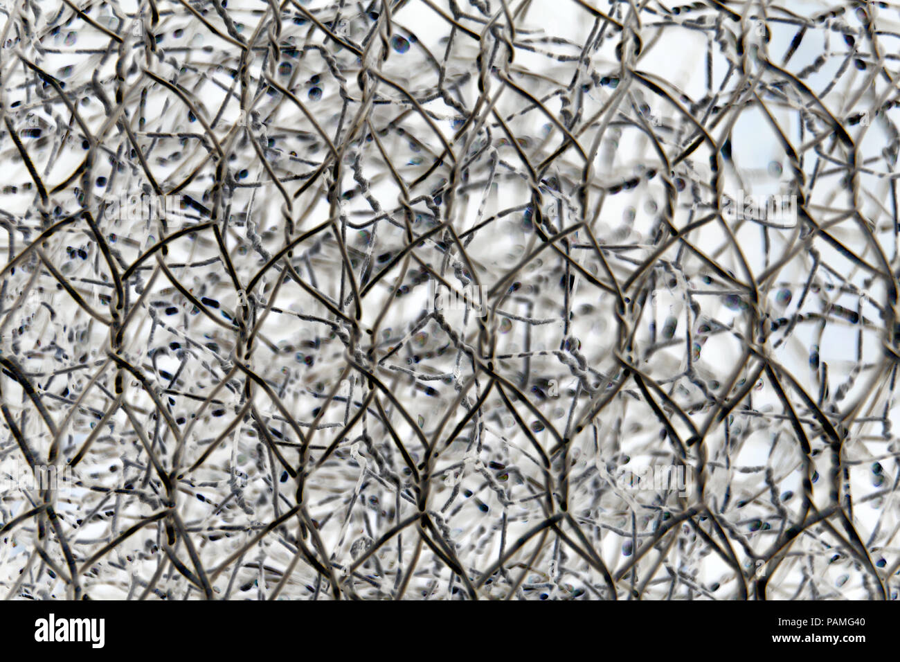 abstract background of a roll of a wire fence with contrasting ...