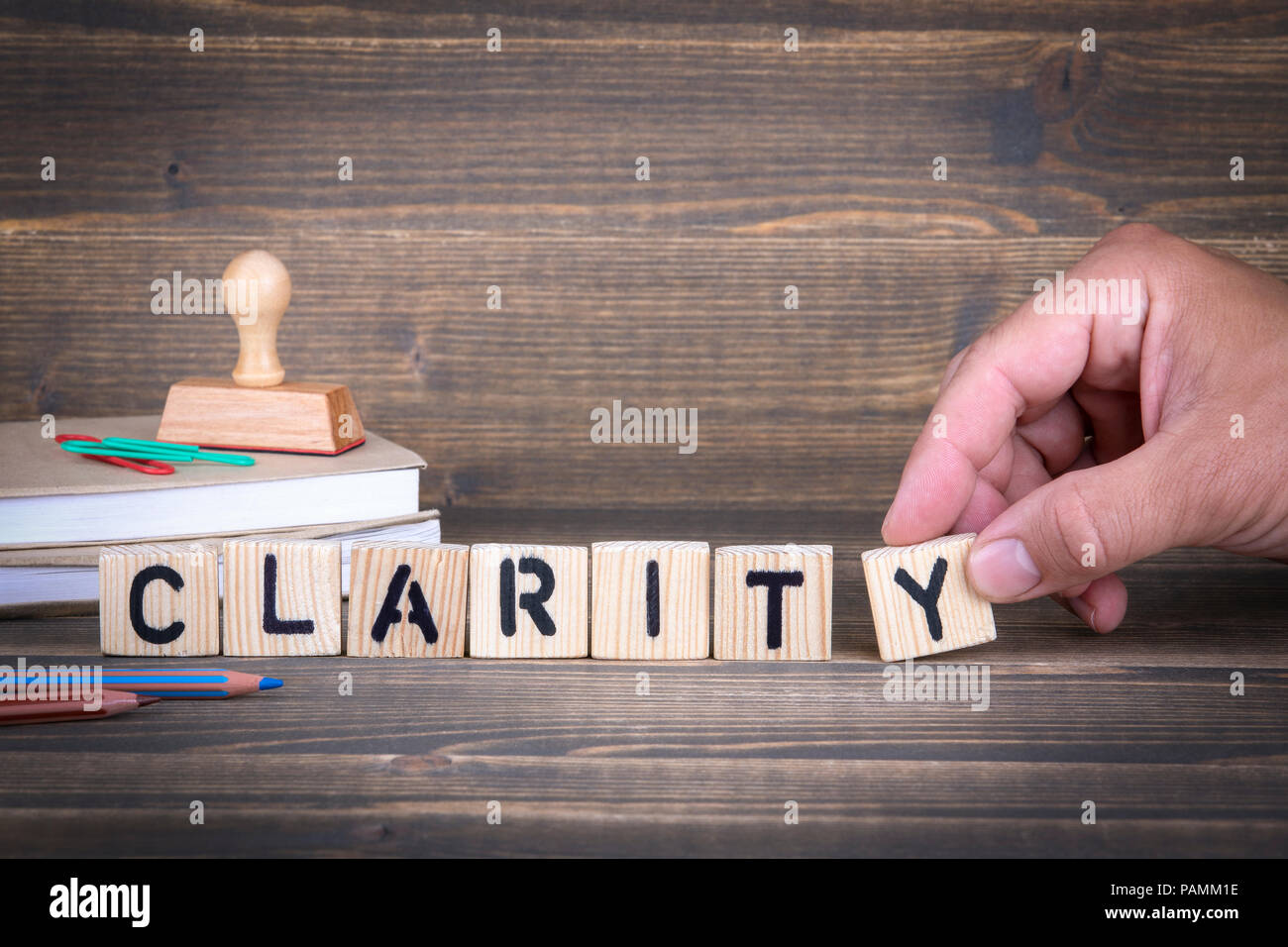 Clarity. Wooden letters on the office desk - Stock Image